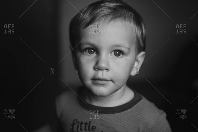 Close up of a little boy in black and white