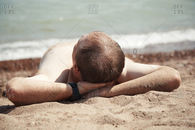 Mid-adult man relaxing at the beach