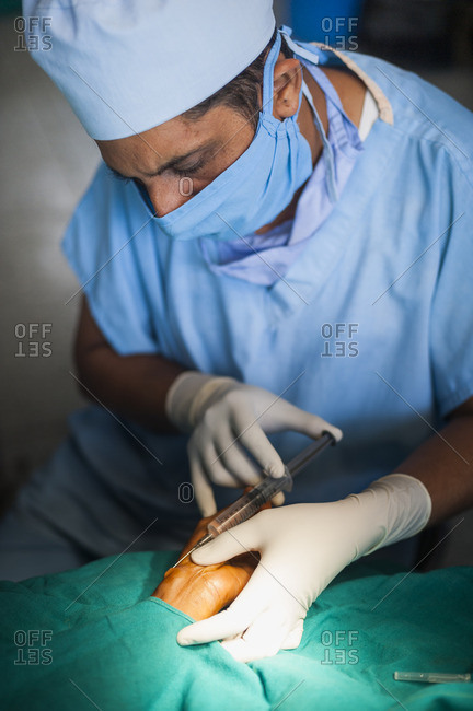A doctor administers anesthetic in a hospital in Nepal