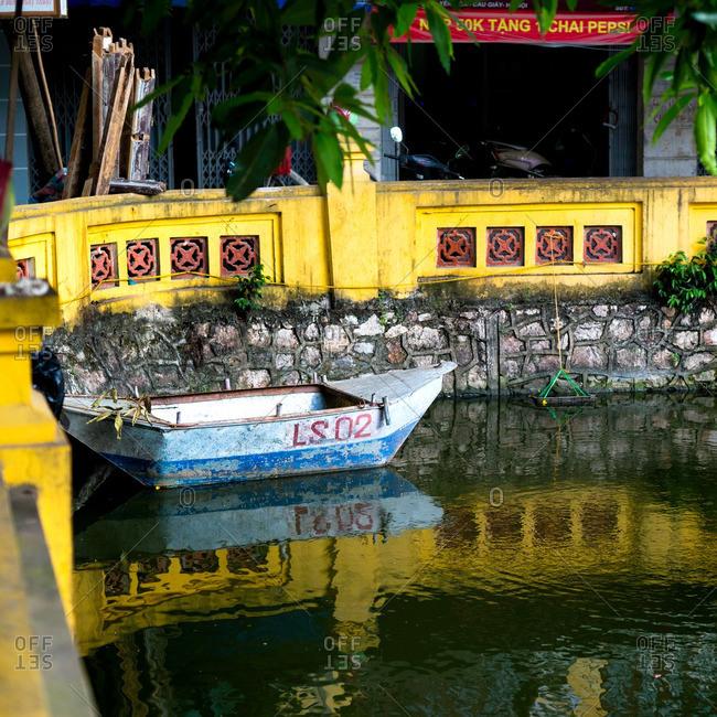 Hanoi, Vietnam - June 25, 2016: Blue rowboat on a small urban pond
