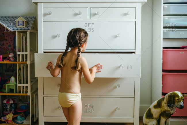 Little girl picking her clothes out