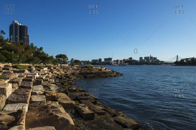 Sydney, Australia - November 2, 2016: Stone blocks along harbor shore