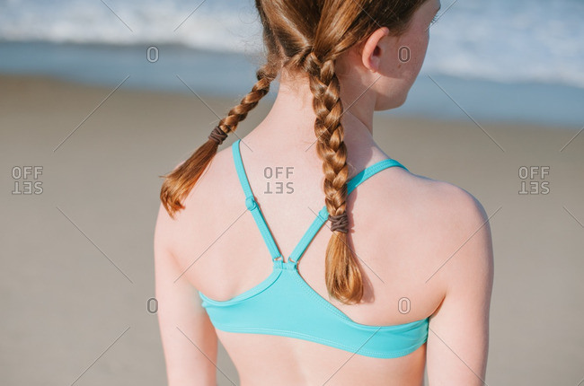Girl with braided pigtails on beach