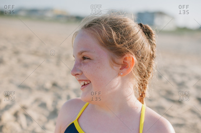 Smiling girl with freckles on beach