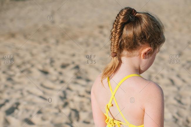 Girl with braided hair on beach