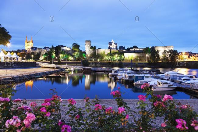 Angers, Pays de la Loire, France - June 27, 2012: France, Pays de la Loire, Angers, Harbor by Chateau d'Angers at dusk
