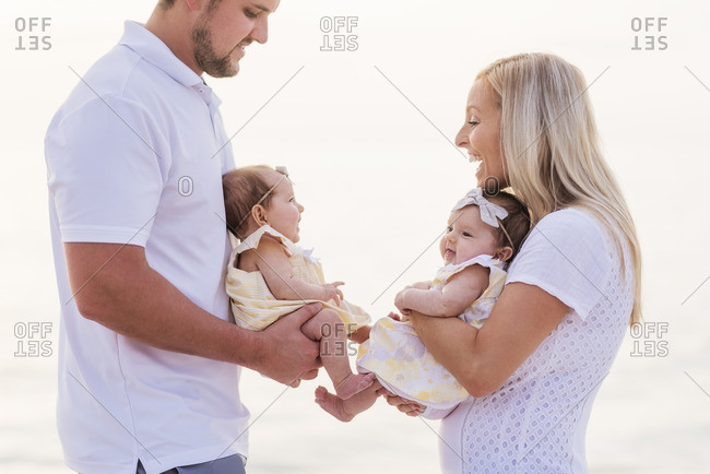 Happy couple with twins (2-5 months)