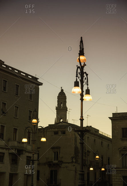 Italy, Puglia, Lecce, Houses in old town at dusk