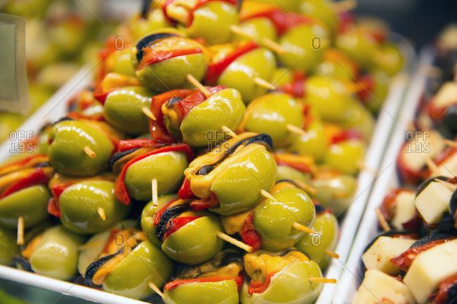 Green olive tapas at the Mercado de San Miguel market in Madrid, Spain