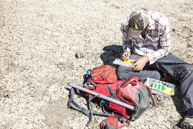 Man collecting desert soil sample