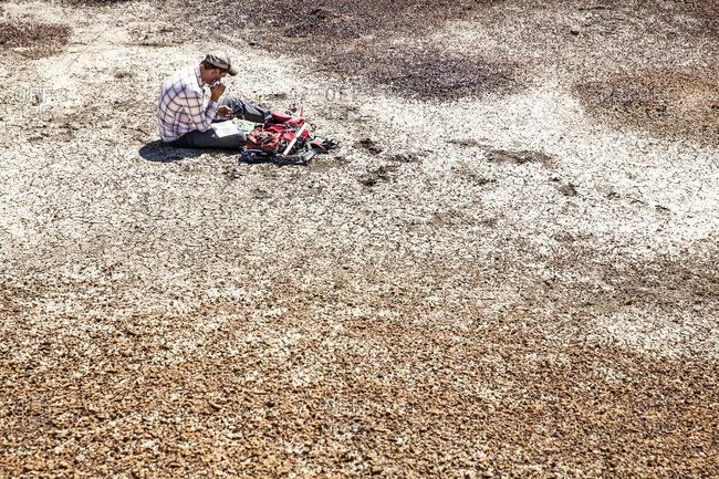 Paleontologist sitting in arid setting