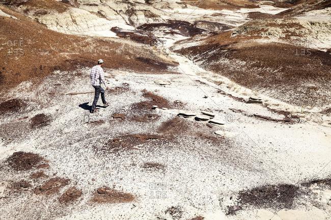 Paleontologist walking in arid hills