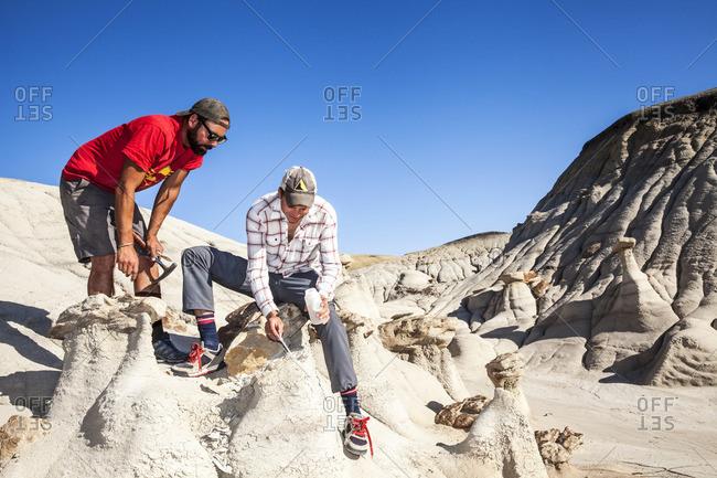 Paleontologists taking sample in desert setting
