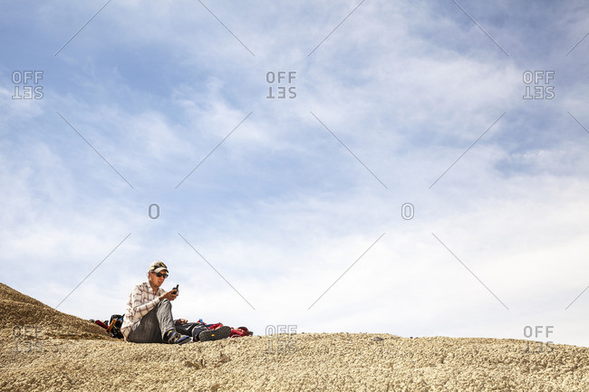 Man with a device in desert
