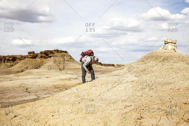Man getting look at desert soil