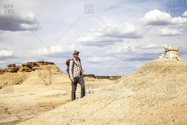 Man backpacking in desert setting