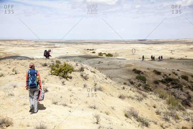 People trekking through desert setting