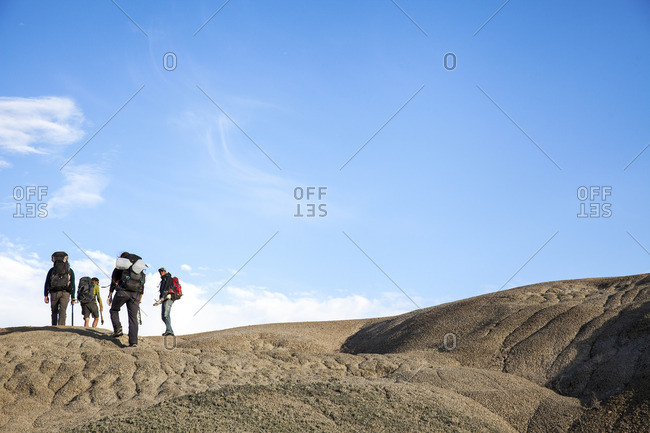 People trekking in New Mexico desert