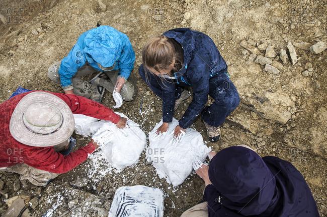 Team making molds of ground in desert