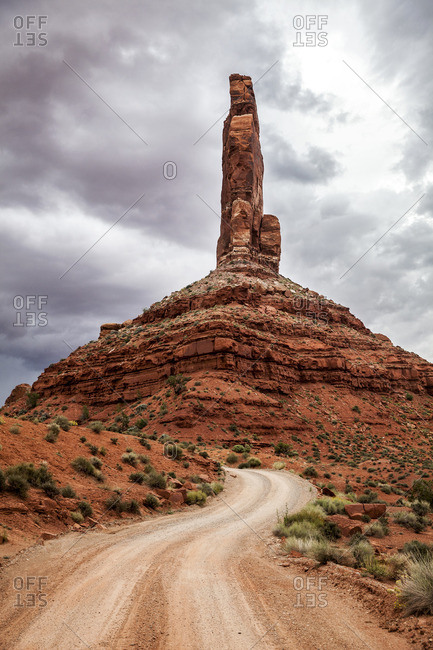 Road by rock tower in New Mexico
