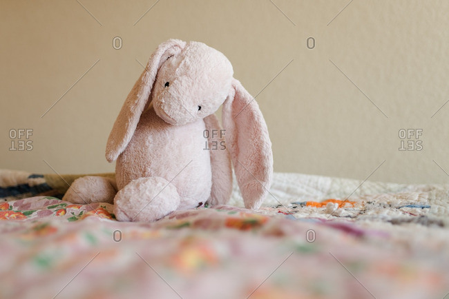 Stuffed bunny alone on quilt
