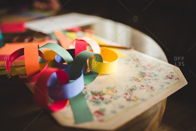 Multicolored paper chains on a vintage placemat
