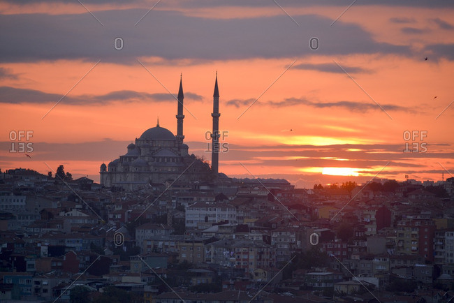 The Mihrimah Sultan Mosque overlooking the city at dusk in Istanbul, Turkey