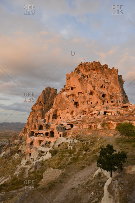 Uchisar Castle mountainside settlement at sunset in Cappadocia, Turkey