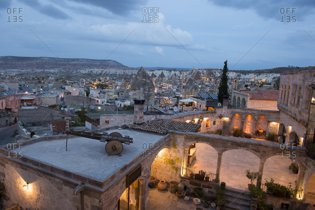 Cappadocia, Turkey - October 26, 2016: Courtyard glowing at twilight overlooking the city