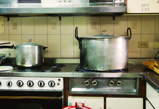 A giant pot takes up all four burners on the stove