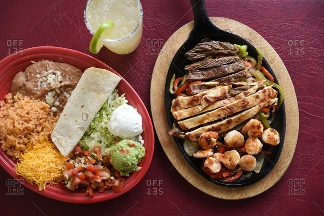 Ingredients for chicken, steak and shrimp fajitas and a margarita