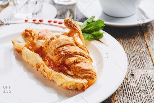 Fresh croissant with jam