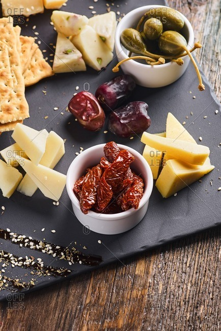 Elevated view of cheese platter served with crackers