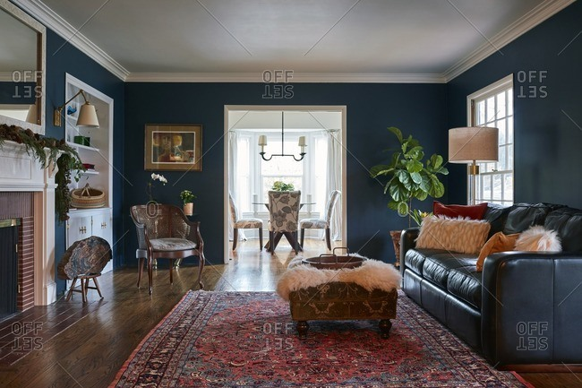 La Canada Flintridge, California - January 22, 2017: Stylish navy blue living room with a sofa and built-ins