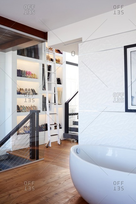 Newport Beach, California - December 20, 2016: Modern bath tub and shoe storage in a loft home
