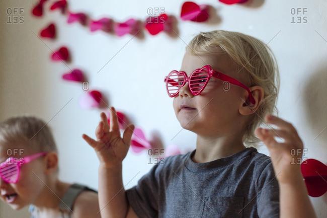 Kids with heart shaped sunglasses