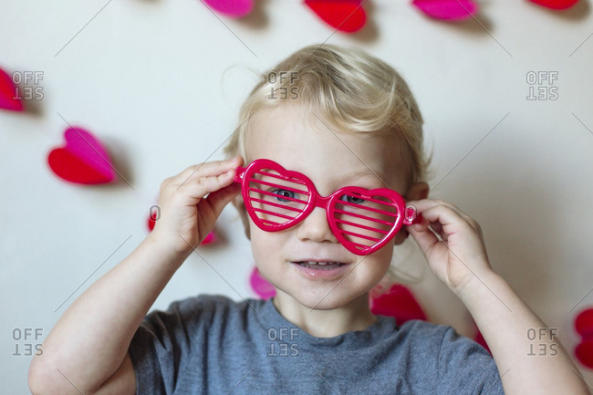 Toddler girl with heart shaped glasses