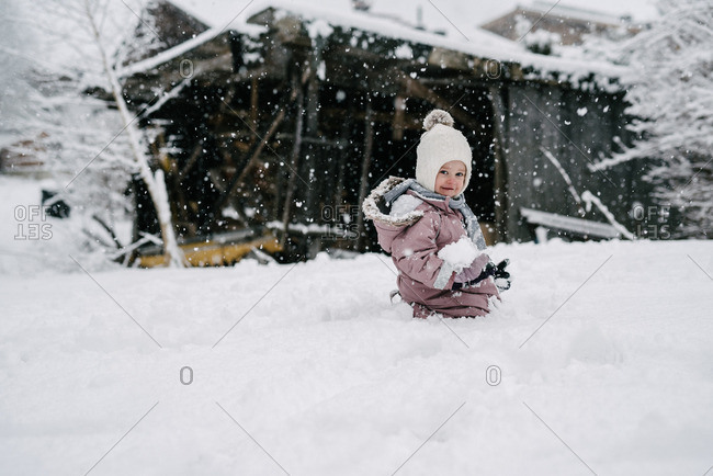 Portrait of toddler girl playing in snow