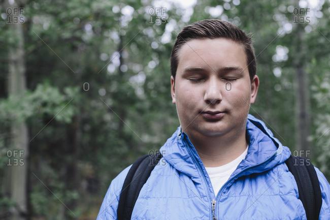 Portrait of moody teenage boy outdoors