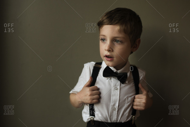 Little boy dressed in bow tie and suspenders