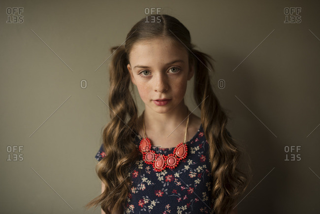 Portrait of young girl with hair in pigtails