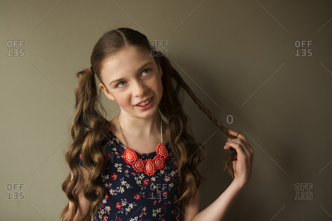 Preteen girl with hair in pigtails