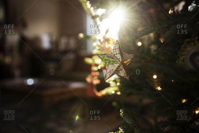 Close-up of star ornament hanging on Christmas tree