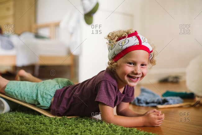Portrait of a smiling boy wearing his underwear on his head