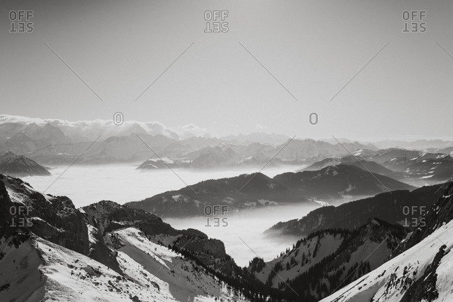 Snow covered mountain landscape in black and white