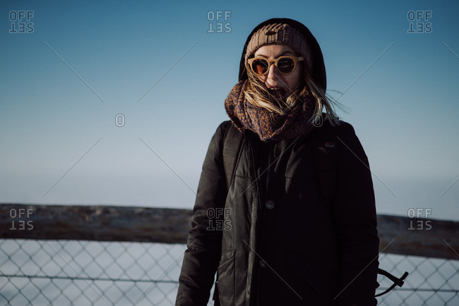Portrait of a woman wearing a winter coat and sunglasses