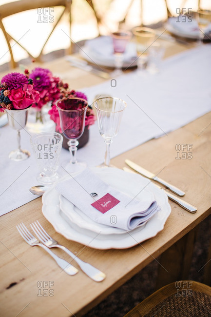 Place setting at wedding reception table