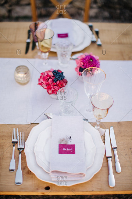 Place settings at wedding reception table