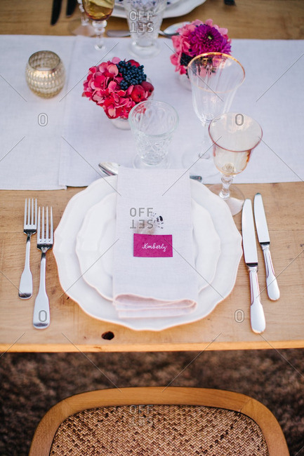 A place setting at wedding reception table