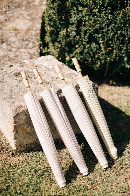 Umbrellas propped against rock